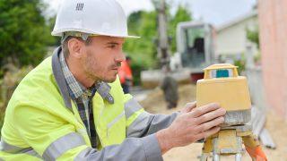 Surveyor taking some measurements